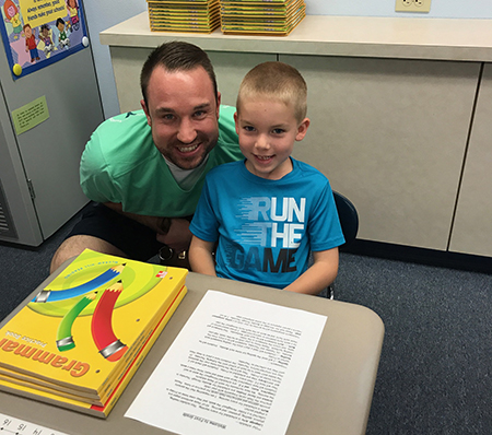 Zach Esplund with his son Miles on his first day of First Grade